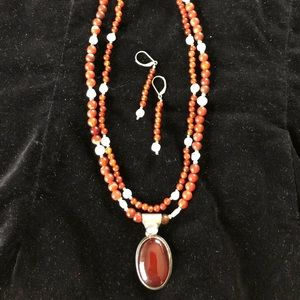 Jewelry - Gemstone set in rust browns, white and silver.